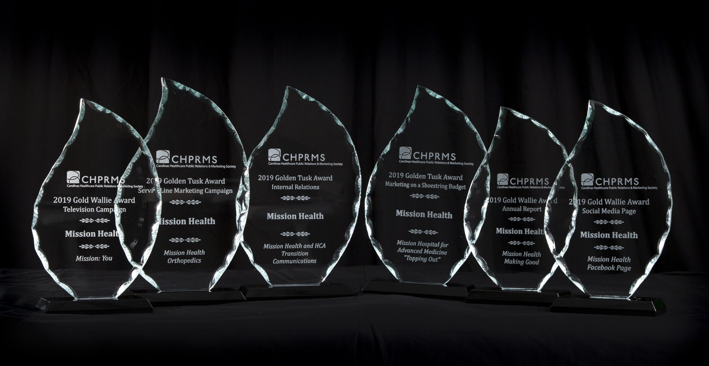 Marketing and Communications Wallie Awards 2019 - Picture of trophies on black background